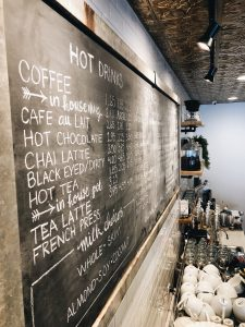 local coffee company chalkboard menu behind the counter