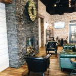 private party room with lounge chairs and stone fireplace