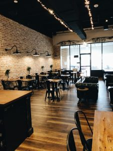 small event venue space with tables and chairs