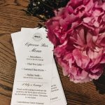 fresh flowers and espresso bar menu on a private event space table