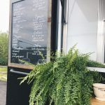 food and coffee truck chalkboard menu with plant