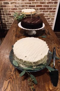vanilla and chocolate cakes sitting in a private party room
