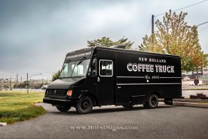 food and coffee truck sitting in a parking lot