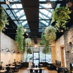 elegant private event space with hanging greenery
