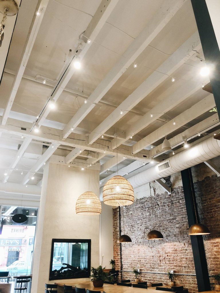 modern private event space with exposed ceiling and large table seating